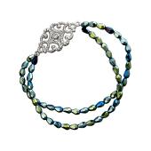 Браслет из двух нитей цветного хрусталя и эффектной ажурной пряжкой из серебра