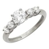 Кольцо, белое золото 5 фианитов один крупный и 4 рядом на шинке.