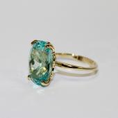 Кольцо с большим наноситалом Параиба, желтое золото