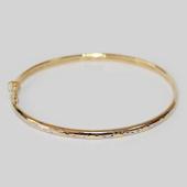 Браслет - обруч с насечками, желтое золото 4мм, длина 55*65 мм