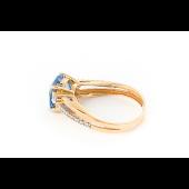 Кольцо с круглым топазом и фианитами из красного золота 585 пробы